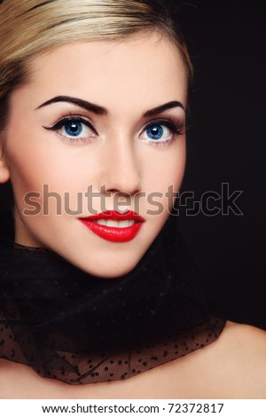 Portrait of young beautiful blond smiling woman with classical glamorous make-up