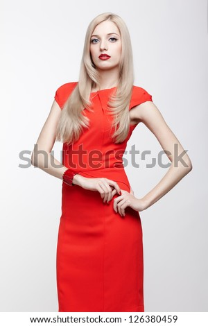 portrait of young beautiful blonde woman in red dress