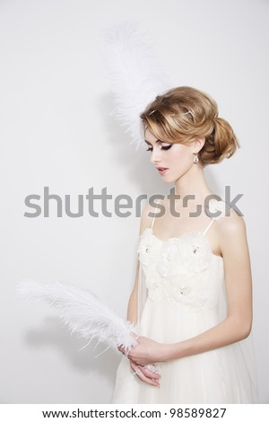 Portrait of young beautiful bride over white background