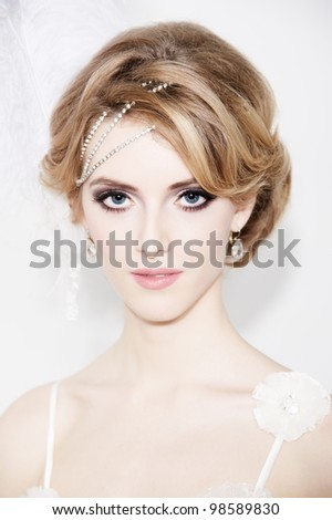 Portrait of young beautiful bride over white background - stock photo