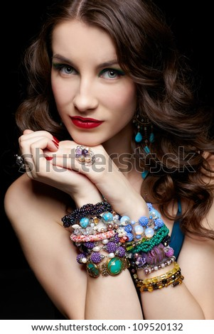 portrait of young beautiful brunette woman in jewellery
