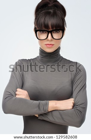 Portrait of young beautiful brunette woman wearing cool glasses
