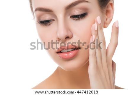 Portrait of young beautiful caucasian woman touching her face isolated over white background. Cleaning face, perfect skin. SPA therapy, skincare, cosmetology and plastic surgery concept