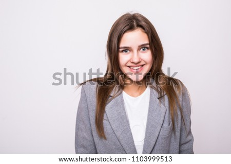 Portrait of young beautiful cute cheerful girl smiling looking at camera over white . #1103999513