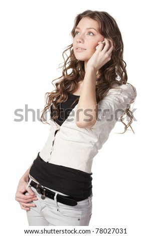Portrait of young beautiful female talking on cell phone isolated on white background