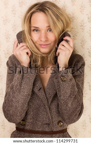 portrait of young beautiful girl in a coat