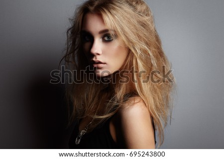 Portrait of young beautiful girl with blonde hair. Fashion photo Hairstyle. Make up. Vogue Style.