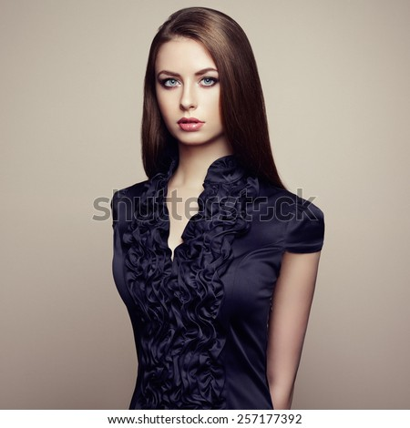 Portrait of young beautiful girl with brown hair. Fashion photo Hairstyle. Make up. Vogue Style.