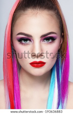 Portrait of young beautiful girl with colorful hair extensions