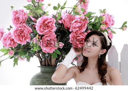 Portrait of young beautiful girl with flower on white background - stock photo