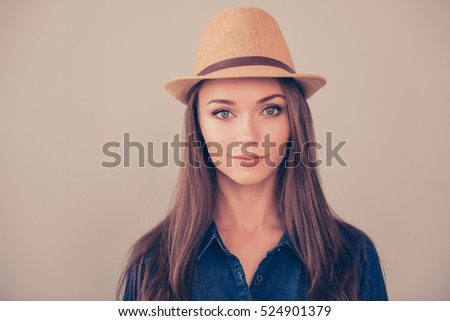 Portrait of young beautiful happy  brunette in summer hat