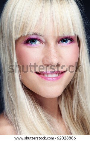 Portrait of young beautiful happy smiling blond girl with freckles
