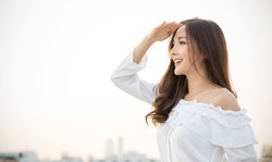 Portrait of young beautiful innocence asian woman in sky roof top. Smile face asian girl wear casual cloth. Beauty treatment perfect clear skin japanese makeup  asia lifestyle concept