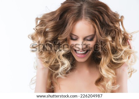 Portrait of young beautiful laughing girl with curly hair. #226204987