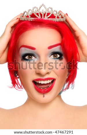 Portrait of young beautiful redhead joyful crying girl with fancy make-up and diadem in hands