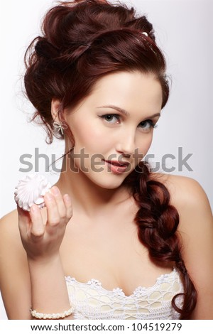 portrait of young beautiful retro woman in vintage clothes and accessories with marshmallow  in hand