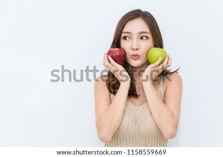 Portrait of young beautiful sexy asian girl with hands holding green and red apple food that made her strong and healthy, Vegetarian woman isolated on white background healthcare and medical concept.