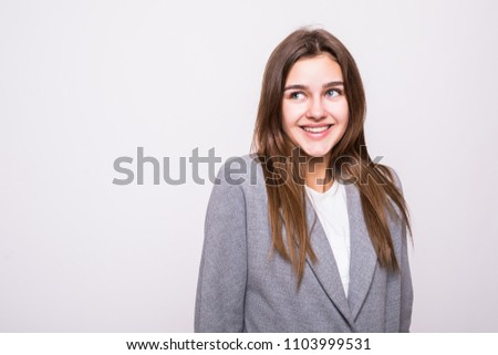 Portrait of young beautiful shy girl smiling looking at camera over white #1103999531