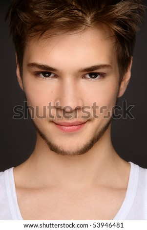 Portrait of young beautiful smiling sexy boy