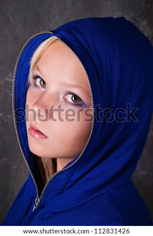 Portrait of young beautiful teen girl in blue hood