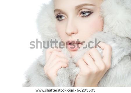 Portrait of young Beautiful wearing white fur