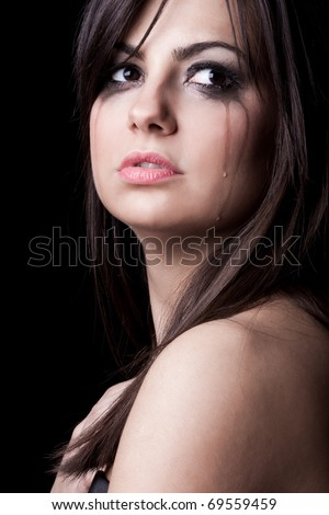 Portrait of young beautiful woman crying