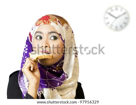 portrait of young beautiful woman eating bread