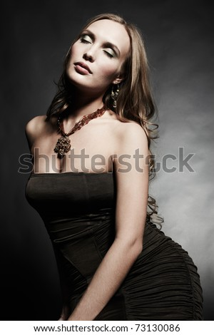 Portrait of young beautiful woman in an elegant evening dress