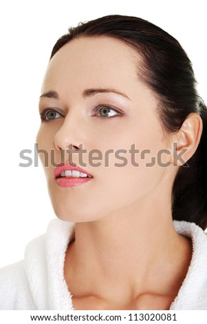 Portrait of young beautiful woman in bathrobe ready for spa