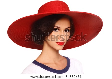 Portrait of young beautiful woman in red hat, on white background