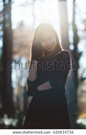 portrait of young beautiful woman in the park with nice morning sunshine - Shutterstock ID 620614736
