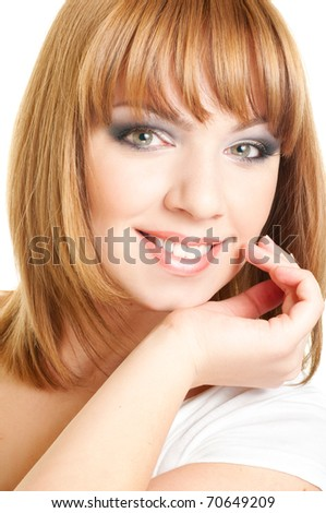 Portrait of young beautiful woman's face with happy cheerful smile