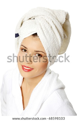 Portrait of young beautiful woman wearing bathrobe, isolated on white