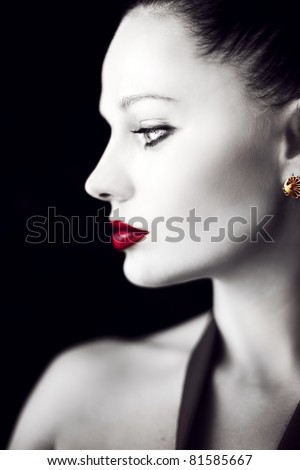 Portrait of young beautiful woman wearing pearls