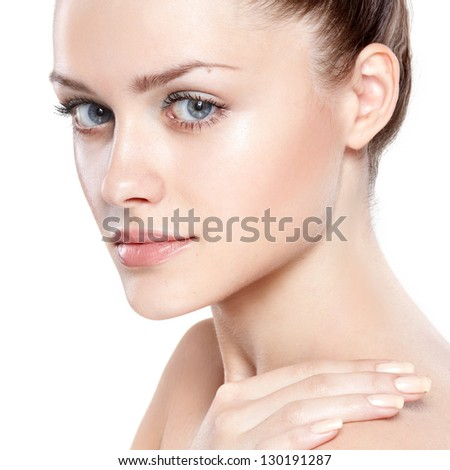 portrait of young beautiful woman with clean skin. On white background