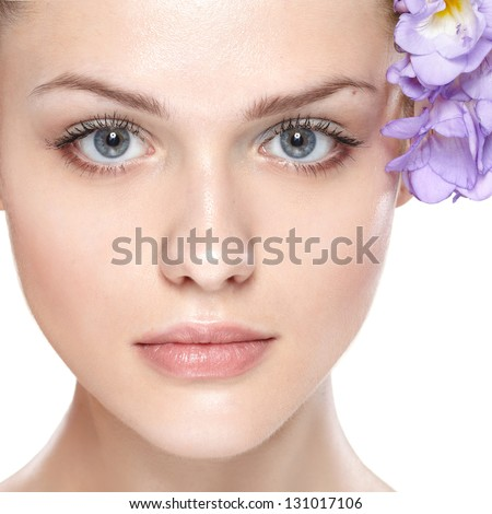 portrait of young beautiful woman with clean skin. with flower in her hair