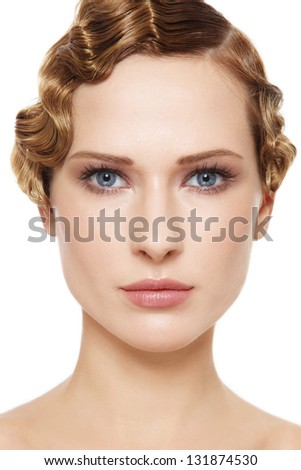 Portrait of young beautiful woman with clear make-up and cold wave hairdo