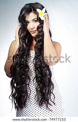 of young beautiful woman with extra long glossy hair - stock photo
