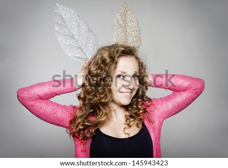 Portrait of young beautiful woman with fake ears