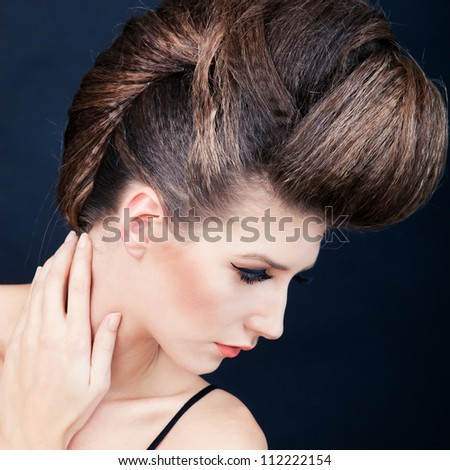 Portrait of young beautiful woman with fashion hairstyle