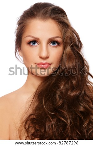 Portrait of young beautiful woman with healthy curly long hair, on white background