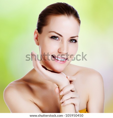 Portrait of young beautiful woman with healthy skin
