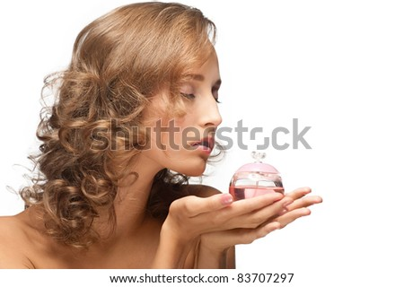 Portrait of young beautiful woman with perfume