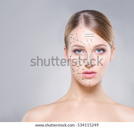 Portrait of young, beautiful woman with pure and smooth skin over grey background. Plastic surgery concept.