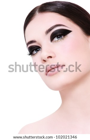 Portrait of young beautiful woman with stylish fancy make-up