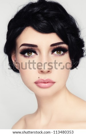 Portrait of young beautiful woman with stylish make-up and hairdo