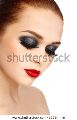 Portrait of young beautiful woman with stylish make-up on white background