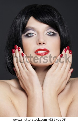 Portrait of young beautiful woman with stylish make-up wearing red lipstick