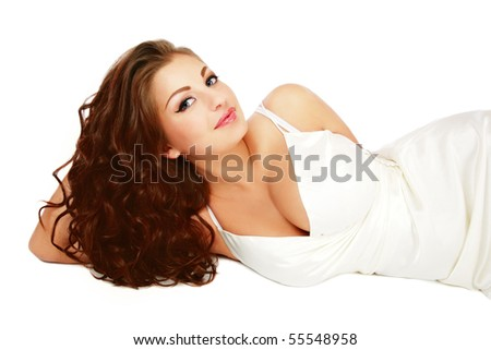Portrait of young beautiful woman with trendy make-up and gorgeous curly hair