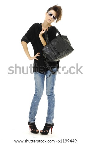Portrait of young beautiful women with her handbag.posing